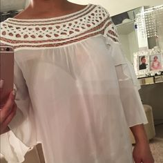 Sheer blouse with intricate detailing size small Sheer blouse you can use a white tube top inside it. Immaculate condition never been used. Intricate detailing for the gorgeous lady😘 Tops Blouses