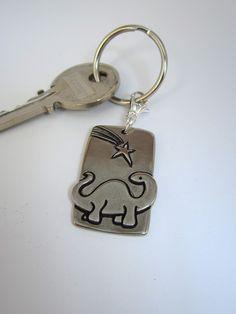 Dinosaur Key Chain. $16.00, via Etsy.