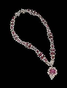 A RUBY AND DIAMOND NECKLACE, BY M. GÉRARD, AND A RUBY AND DIAMOND PENDANT, BY VAN CLEEF & ARPELS