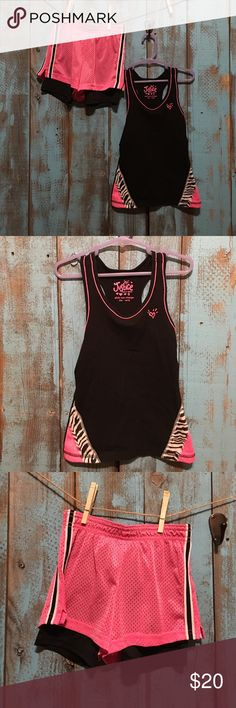 Justice tank and short set girls size 6 Excellent condition! Always washed in cold and hung dried. Little girls Justice tank with shorts. The tank has a razor back and the shorts are mesh with black spank type of material underneath. Super cute set!! Size 6 Justice Matching Sets