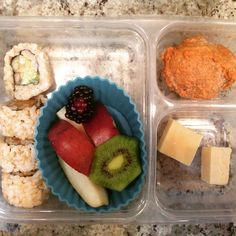 School lunch: avocado cucumber roll from @wholefoods with red pear slices, kiwi and blackberry, homemade banana muffin from freezer and cubes of @kerrygold dubliner cheese. #schoollunch #organic #pears #sushi #avocado #homemade #muffin #freezermeals #kerrygold #healthytips #healthykids