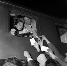 AUDREY AND MEL FERRER LEAVING TERMINI TRAIN STATION IN ROME   March 5th 1960