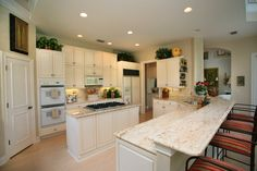 Extra long two-tiered peninsula with eat-in counter plus island gives this kitchen plenty of counter space.