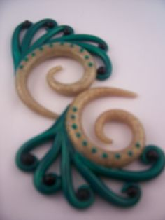 Peacock inspied ear gauges by Mariahssassyfashions on Etsy, $22.00