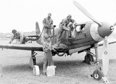 Loading the machine guns of a P-39 Airacobra