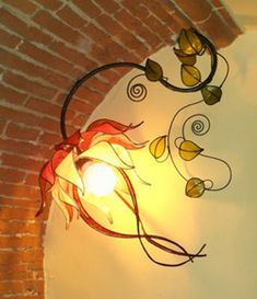 Lampa Dani: stained glass floral light fixtures that threaten to come to life!