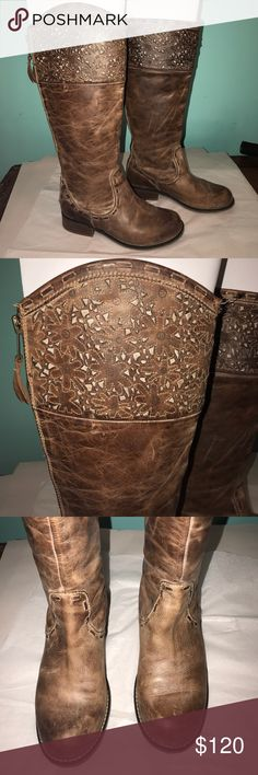 """Buckle boots Great condition!  Bought at Buckle. Beautiful laser cut detail at the top of the boots. Zips up the back with a cute tassel. Shaft height is 16"""". Shaft outer circumference is 15.5"""".  The only flaw is at the top of one boot., shown in last pic. These fit more like a 7. Corral Boots Shoes Winter & Rain Boots"""
