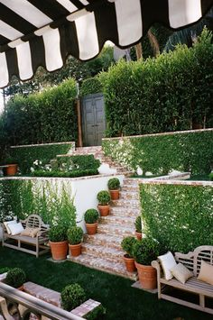 Black and white striped awning in a Hollywood Hills garden. Design by Mark D. Sikes #OutdoorLiving
