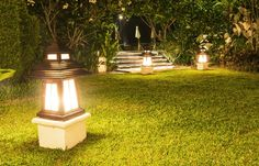 10 Ways To Illuminate Your Yard With Landscape Lighting Outdoors It is important that you understand the benefits of choosing to use the best yard lighting. The number one reason is that it will improve the look of ... Nim C, Landscape Lighting Design, Large Lanterns, Mediterranean Style Homes, Backyard Lighting, Garden Lamps, Types Of Lighting, Lighting Ideas, Cool Landscapes