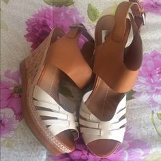 [BOGO 50%] NWOT Dolce Vita Platform Wedges DV By Dolce Vita Brand New without box Size: 9.5 Brown/White New without box Heel Height: 4 3/4 Inches Platform Height: 1 1/4 Inches Closure: Buckle Material: Leather/Man Made                                    Bundle for discounts! Thank you for shopping my closet! DV by Dolce Vita Shoes Platforms