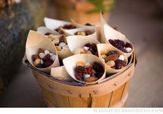 use scrapbook paper with a wood grain to make cone snack holders. Ideal for a woodland themed baby shower