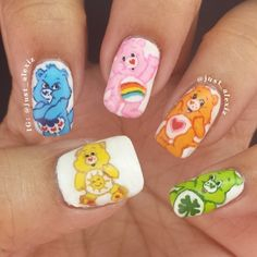 Care Bears nail art featuring Funshine Bear, Grumpy Bear, Cheer Bear, Tenderheart Bear, and Good Luck Bear!