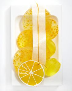 Lemon Soap Packaging  Sunny slices of lemon-tinged soap on a soap dish make a beautiful (and practical) gift. Add a glassine band and waxed-twine tie. For the lemony tag, cut a circle of yellow glassine, and embellish it with a white gel pen.
