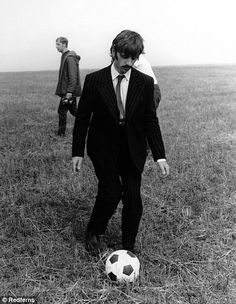 Ringo Starr playing football in a field outside Newquay during filming of Magical Mystery Tour in 67