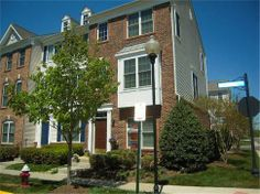 Spacious Brick Front End Unit Town Home! 42842 McComas Terrace, Chantilly, Virginia. 4 bedrooms, 3 baths, 1 partial bath, 1836 sq ft., Colonial style, 2-car garage attached.  Spencer Marker & co.  www.seln4u.com