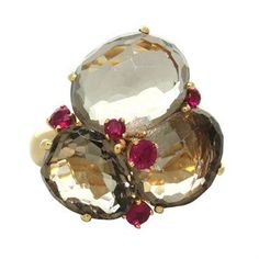 Pomellato 18k rose gold ring with smokey quartz and rubies from Bahia collection  DESIGNER: Pomellato  MATERIAL: 18K Gold  GEMSTONE: Ruby, Quartz  RING: STYLE Ring  DIMENSIONS: Ring size - 6, ring top is 24mm x 23mm  WEIGHT: 19.5g  MARKED/TESTED: Pomellato,750  CONDITION: New  PRODUCT ID: 11963