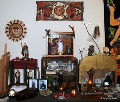 I love how this person set up the different heights on their altar. I'm thinking about doing the same for my altar. There never seems to be enough room. : O