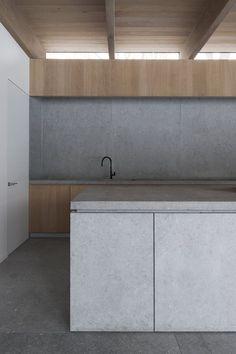 Wood and whitewash of cabinets, ceiling & wood below transom.  DD residence, Waregem, 2012 - Vincent Van Duysen Architects: