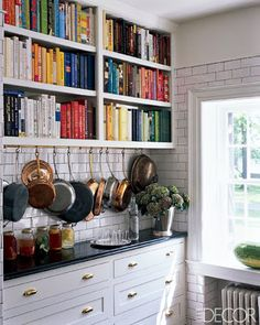 Gorgeous Kitchen- subway tile, cup pulls, rainbow arranged cookbooks.Here's some open shelving I actually love. I think I could get away with a similar look using my hutch but I'll need more cook books- and Allclads!
