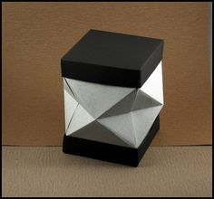 Diamond Cut Origami Box.  Designer: Makoto Yamaguchi in his book Origami Zakka Units: Lid & Base = 1 square each; Body = 4 squares Paper: Canson Ingres.  In Yamaguchi's book, this design is called a Flower Vase Cover or a Penstand.  Also there are no lids for this in the book, and no rim to put the lid over.  There is a bottom to the box in the book.   I figured out how to make the rim.