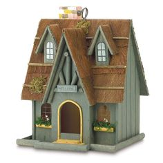 "A cute cottage with a 2 1/8"""" x 2 7/8"""" door, this delightful birdhouse with thatch roof, chimney and flower boxes will be a welcome addition to many different birds in your garden."