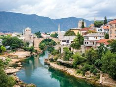 While most travellers to Eastern Europe visit Sarajevo, the Bosnian capital, the smaller city of Mostar in the Herzegovina region is well worth the trip. The picturesque city is home to the Balkans' most celebrated bridge, Stari Most, a magical stone arch Countries To Visit, European Countries, Most Beautiful Cities, Bosnia And Herzegovina, Day Tours, Day Trip, Weekend Trips, Weekend Getaways, Places To See