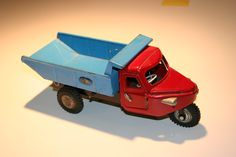 One of my favorite antique toys, a three wheeled truck which has a mechanism to unload the contents of the blue back.