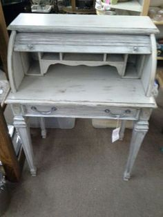 $155  - This is a petite roll top desk. Painted grey with gold accents in, distressed. One long single drawer, and cubby space behind the roll top. It stands 41 inches  to the tallest point . The desk measures 30 inches across the front, 19 inches deep. It can be seen in booth C 19 at Main Street Antique Mall 7260 East Main St ( E of Power Rd ) Mesa 85207  480 9241122open 7 days 10 till 530 Cash or charge 30 day layaway also available