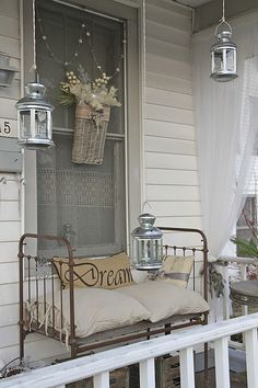 Old Crib...re-purposed into a vintage bench for the front porch.  Just add cushions or pillows for padded seating.