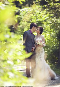 candid bride and groom kissing shot in the garden