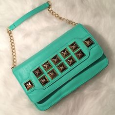 Betsey Johnson Spring-glam studded clutch! Betsey Johnson studded clutch! Beautiful mint cool for Spring! Used one time! Roomy inside holds phone, wallet, makeup and has a hidden pocket for girlie needs. Strap can be detached. Betsey Johnson Bags Clutches & Wristlets