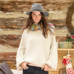 "JETE DOLMAN PULLOVER -- With an always-flattering bateau neckline and delicate pointelle stitching, our horizontal knit pullover makes any outfit instantly elegant. Acrylic, wool, nylon, alpaca. Hand wash. Imported. Exclusive. Sizes XS/S (2 to 6), M/L (8 to 14), XL (16). Approx. 23""L."