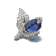 SAPPHIRE AND DIAMOND CLIP, CARTIER, CIRCA 1950 Of foliate andfruit inspiration, set with single-, circular- and brilliant-cut diamonds and a polished sapphire bead, mounted in platinum, signed Cartier Paris and numbered, French assay and maker's marks.