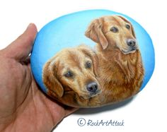 Custom portrait painting of two golden retriever dogs on a 5 inches natural sea rock! I used acrylics and 2 layers of gloss varnish at the end for pritection. Hand painted by Lefteris Kanetis from Rock Art Attack.