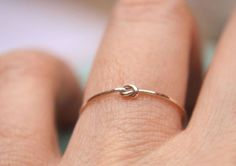 """knot"" ring. Symbolizing that one day you will tie the knot and marry them. Promise ring."