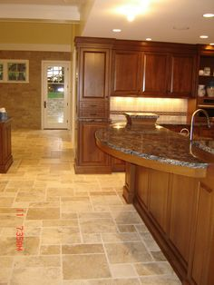 Travertine floors over a heated floor system make this kitchen a great place to cook.