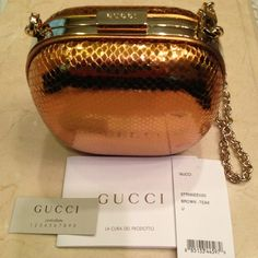 "Gucci Gold Snake Embossed NWT 'Anjelica'Clutch Gucci Snake Embissed Leather 'Anjelica' Metal Frame Clutch/Crossbody.  Measured 5""x5""x2"".  Clip removable 48"" chain link shoulder strap with 24"" drop. NWT Gucci Bags Clutches & Wristlets"