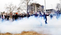 Police using tear gas shells and water canon to disperse NHM employees at Partap Park Srinagar.       -Excelsior/ Shakeel