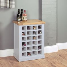 A truly eye-catching wine rack that will have your guests green with envy! Part of our fresh and elegant grey painted Chadwick range Beautifully crafted painted furniture with carefully selected satin lacquered oak veneer tops Exceptionally built thr Grey Painted Furniture, Oak Furniture House, Online Furniture, Furniture Ideas, Wine Rack Table, Oak Wine Rack, Wine Racks, White Wine Rack, Wooden Wine Cabinet