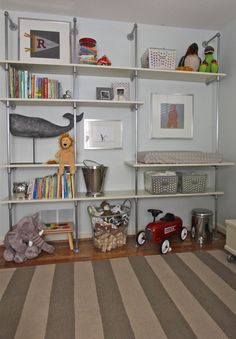 Love these DIY pipe shelves for a kids room or even a mud room for coats, shoes, and the like Woodworking Projects That Sell, Diy Wood Projects, Home Projects, Kids Woodworking, Diy Pipe Shelves, Pipe Shelving, Wood Shelves, Le Logis, Kid Spaces