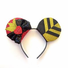 A personal favorite from my Etsy shop https://www.etsy.com/listing/256965741/queen-of-hearts-mickey-ears-disney