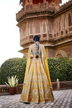 Looking for Back shot Anita dongre yellow and turquoise lehenga? Browse of latest bridal photos, lehenga & jewelry designs, decor ideas, etc. Indian Bridal Fashion, Indian Wedding Outfits, Indian Outfits, Indian Clothes, Indian Gowns, Indian Attire, Indian Ethnic Wear, Mehendi Outfits, Dress Indian Style