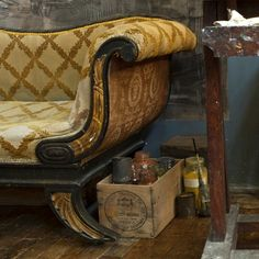 Charleston: the home of artists Vanessa Bell and Duncan Grant.  Charleston studio Sickert sofa.