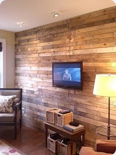 Pallets on the wall . . . behind the TV above the fireplace in the nook