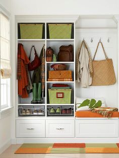 This is similar to what our revamped entry closet will look like...not quite as professional, since I'm constructing it, but the same basic layout : ) This motivates me to finish it!
