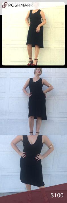 Diane Von Furstenberg Dress Black knee length rayon midi dress. Ever so slightly asymmetrical, V-neck, sleeveless. Tag reads size 10 but it's closer to a size 8. Diane von Furstenberg Dresses Midi