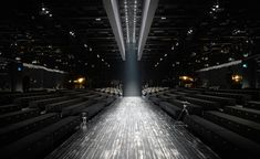 Men's A/W 2014 season / Gucci: The Gucci show space got a little update this season. Dressed up in darker hues, the venue featured a black parquet catwalk and black velvet seats to match Frida Giannini's moodier sensuality
