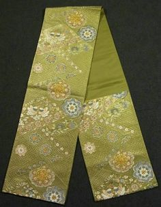 Vintage 'rokutsu' fukuro obi with a flower circle and mythological bird pattern, embroidered with a drawn work technique and woven-in shiny gold coated threads on the background.