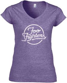 This Foo Fighters women's tshirt spotlights the alternative rock band's logo. Formed in 1995 by former Nirvana drummer, Dave Grohl, after Nirvana disbanded due to the sudden death of lead singer Kurt Cobain, the Foo Fighters have gone on to release 8 albums and win 11 Grammy awards. This Foo Fighters women's junior tee is made from 100% purple cotton with distressed effects to the Foo Fighters logo for a vintage look and feel. #FooFighters #RockerRags