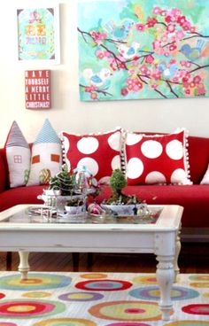 Followed her blog for over a year. LOVE the pillows and red couch!